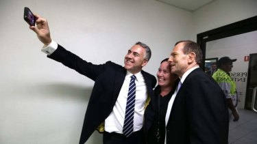 "Shadow treasurer Joe Hockey, Carmel Busby and Opposition Leader Tony Abbott take a ""selfie"" during their visit to a beef processing plant in Queensland during the election campaign."