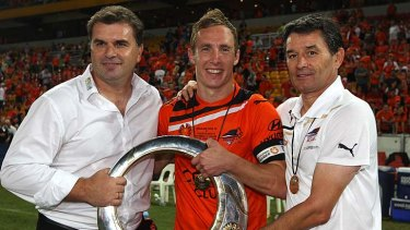 (L-R) Ange Postecoglou, Matthew Smith and Dario Vidosic of the Roar hold the winners trophy after the 2012 A-League Grand Final.