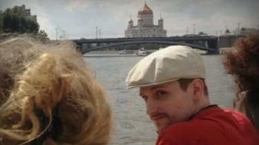 Closely protected: A man said to be US fugitive Edward Snowden is photographed cruising the Moscow River in a picture published on a Russian website.