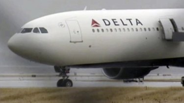 The Delta Airbus 330 airliner sits on a runway at Detroit Metropolitan Airport.
