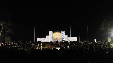 Crowds surround the Australian War Memorial for the solemn dawn service on Anzac Day 2013.