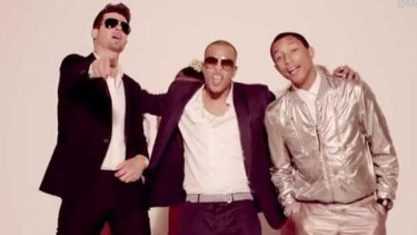 Happier times: Robin Thicke with Pharrell Williams and T.I in the Blurred Lines film clip.