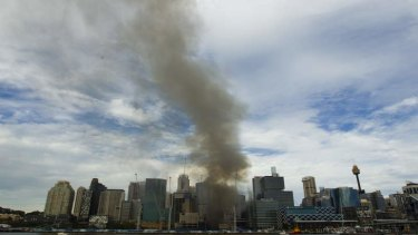 A smoke plume rises from the Barangaroo site.