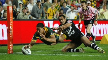 Playing for the Kangaroos: Folau scores a try against New Zealand at the SFS in 2008.
