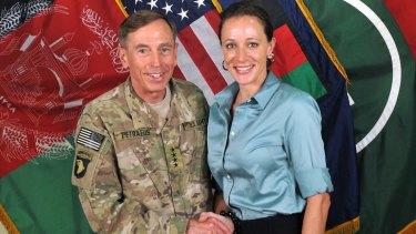 General David Petraeus, left, shaking hands with Paula Broadwell.