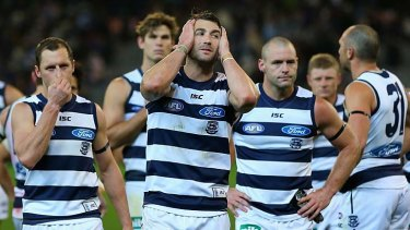 Devastation: Geelong players James Kelly, Corey Enright, Josh Hunt and James Podsiadly after the 16-point loss to Fremantle.