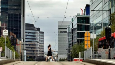 On the wrong track: The view down Collins Street looking west. Docklands has been ruled a soulless, dispiriting, windswept failure, its waterfront dominated by soaring towers.