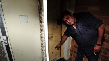 Close call ... Albert Ferguson shows where his front door was shot at early yesterday.