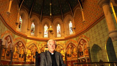 Father Ramsay Williams in the Anglican All Saints church in St Kilda.