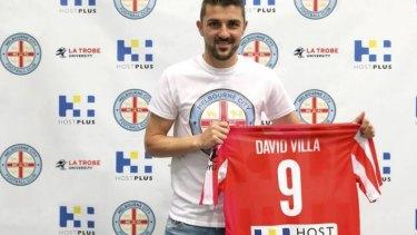 City slicker: Spain's World Cup winner David Villa signs on.