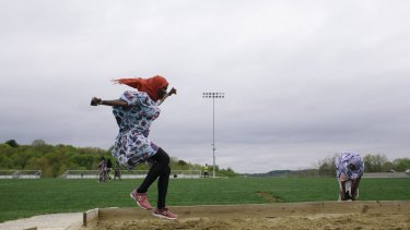 Johorey Abdirahman, left, and Zahara Abdi, members of the Lewiston High School track team, at practice in Lewiston, Maine, in May 2015.