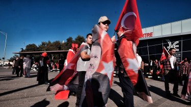 Members of Melbourne's Turkish community meet outside Broadmeadows Library in Melbourne, in support of Turkey's president after a failed coup attempt in Turkey.