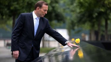 Prime Minister Tony Abbott visited the 9/11 Memorial in New York pausing at the names of Australian victims.