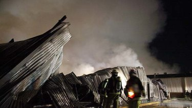 Still burning ... more than 100 firefighters fought the blaze.