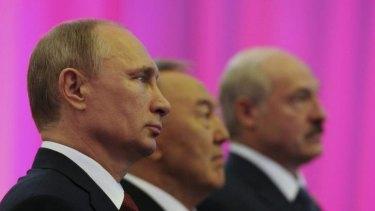 Russian President Vladimir Putin (left), Kazakh President Nursultan Nazarbayev (centre) and Belarus President Alexander Lukashenko are photographed before a meeting of the Eurasian Economic Union.