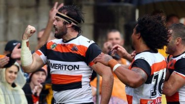 Boilover: Aaron Woods celebrates his try against Manly.
