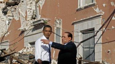 Devastation... US President Barack Obama tours the earthquake-hit Italian town of Onna with Italian Prime Minister Silvio Berlusconi in 2009.