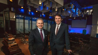Telstra chief financial officer Andy Penn (left) and chief executive David Thodey (right).
