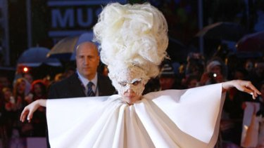 Up in the air ... Lady Gaga arrives at the Brit awards.