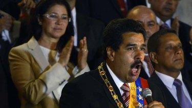 Acting President: Nicolas Maduro is applauded by partner Cilia Flores.