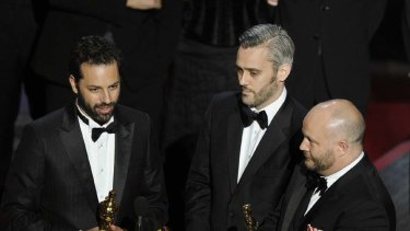 Emile Sherman, left, Iain Canning  and Gareth Unwin  accept the Oscar for best motion picture for The King?s Speech.