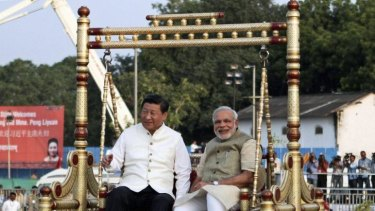 Chinese President Xi Jinping and Indian Prime Minister Narendra Modi sit on a traditional swing by the Sabarmati River in Ahmedabad.