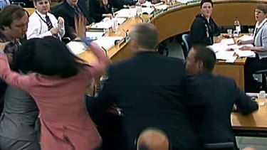 Wendi Deng strikes back at Jonnie Marbles during the inquiry after he threw a foam pie at her husband, Rupert Murdoch.