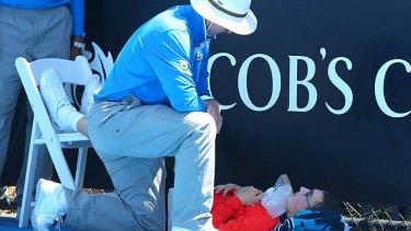 Health at risk: A ballboy faints.