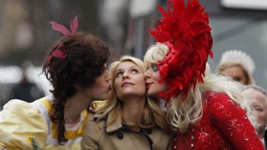 Claire Danes is kissed by members of Hasty Pudding Theatricals.