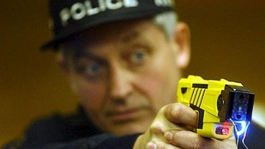 New health fears ... A police officer deploys a Taser stun gun.