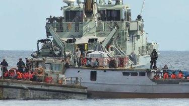 Australian Customs process a boatload of asylum seekers at Flying Fish Cove, Christmas Island.