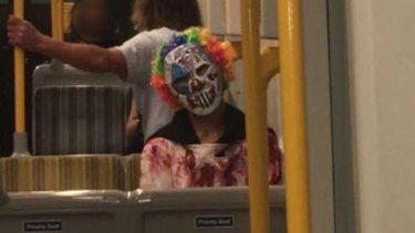 A clown photographed on public transport in Surfers Paradise on the Gold Coast.