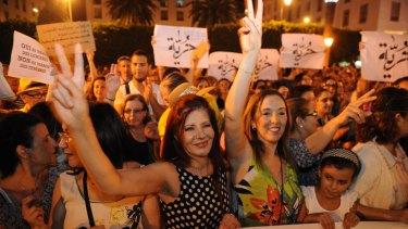 "Moroccan women, wearing sleeveless garments in solidarity, protest to support two women who are being prosecuted for wearing  ""inappropriate"" clothing and who have been charged with the offence of gross indecency."