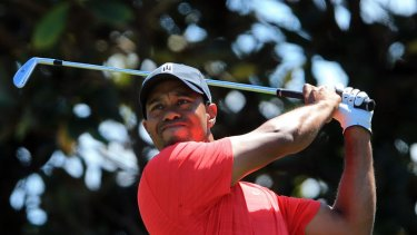 Back in the red ... Tiger Woods