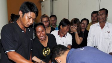 Relatives cry as they remove the body of Suwan Sudmun, a Thai victim of Monday's bomb blast.