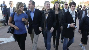 Opposition Leader Tony Abbott casts his vote with wife Margie and daughters (left to right) Francis, Bridget and Louise, at the Queenscliff Surf Lifesaving Club in his seat of Warringah yesterday. <i>Picture: Glen McCurtayne</i>