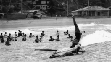 The rage ... Adrian Curlewis stunting on a timber board at Palm Beach.