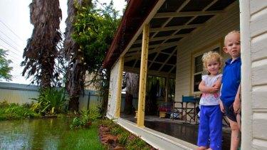 Rain, rain, go away ... Sophie and Lochie Michell at their Narrabri home.