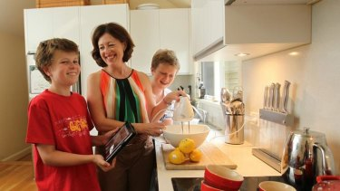 Lisa McLean, with sons Declan (left) and Hayden, has ditched cookbooks for  her iPad.