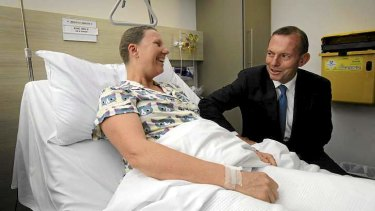 New order: Tony Abbott, with breast cancer patient Hilary King, announces funding for chemotherapy infusion drugs at The Mater.