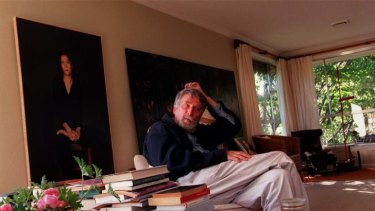 Pierre Ryckmans at home in Canberra in 1999 with a portrait of his daughter, publisher Jeanne Ryckmans, by Matthew Lynn.