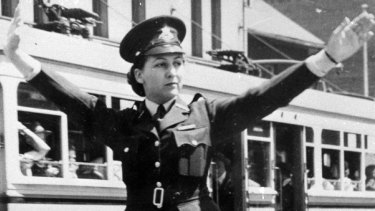 NSW policewoman Amy Millgate directs traffic in 1948.