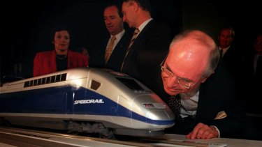 "Former prime minister John Howard takes a close look at a ""Speedrail'' model in 1998."