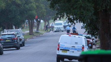Mr Davey's body is removed from the scene on Stafford Street, Kingswood, on Wednesday morning.