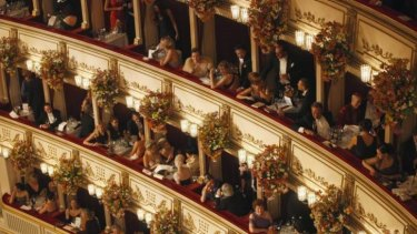Awaiting Strauss: People sit in their boxes at the Vienna State Opera House.
