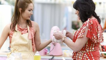 Hot in the kitchen: <i>The Great Australian Bake Off</i> co-host Anna Gare helps Nancy, a contestant, after she burnt herself during filming.