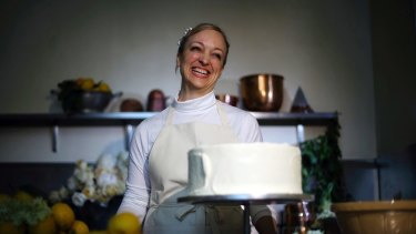 Claire Ptak, owner of Violet Bakery, and her cake.