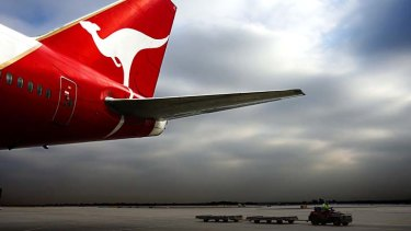 Qantas yields to pressure to lower credit card surcharges.