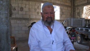 Mahrous Siyam, 67, holding a handwritten list of his family members.