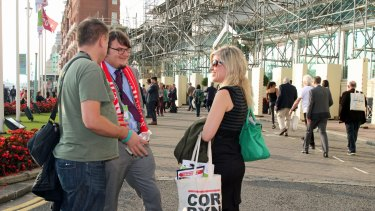 Labour Party supporters with Jeremy Corbyn merchandise.